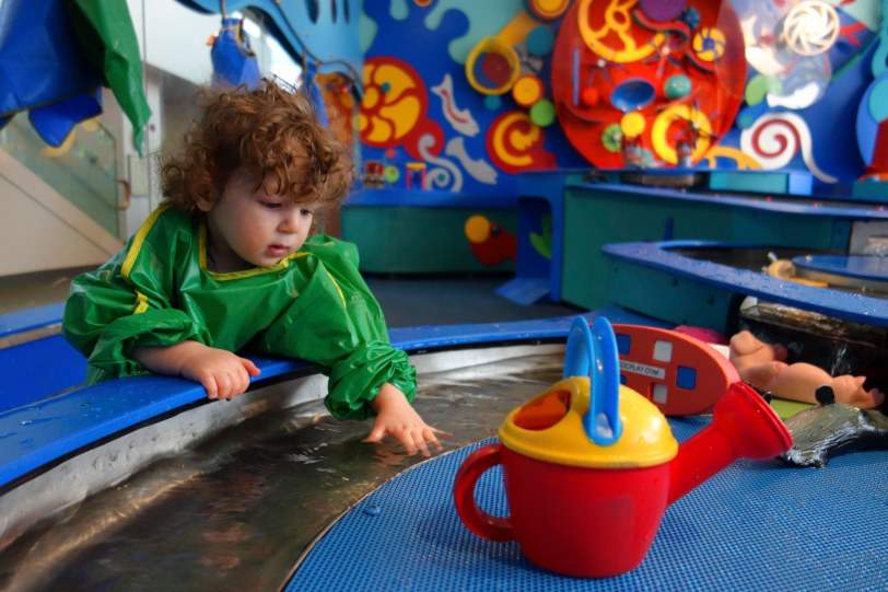 theo at brooklyn childrens museum playing with water
